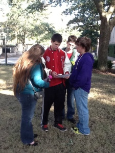 A student study group uses QR codes to complete performance tasks during a field trip.