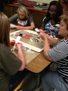 Mrs. Safley teaching a small group the fletching process.